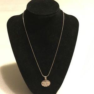 Vintage sterling silver sand dollar necklace